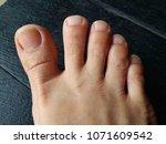 bare foot  asian woman foot on... | Shutterstock . vector #1071609542