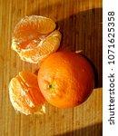 orange on the table   Shutterstock . vector #1071625358