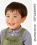 boy with cute smile. editorial... | Shutterstock . vector #1071650492