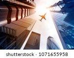 plane flying over highrise... | Shutterstock . vector #1071655958