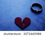 cracked red heart and broken... | Shutterstock . vector #1071665486