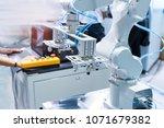 robotic pneumatic piston sucker ... | Shutterstock . vector #1071679382