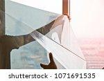building windows film... | Shutterstock . vector #1071691535