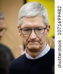 Small photo of Tim Cook, Chief Executive Officer of Apple Inc., torus a technology lab after the launch event for the iPad 6 at Lane Technical College Prep High School in Chicago, Illinois, U.S., March 27, 2018.