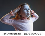 the anger and surprised teen... | Shutterstock . vector #1071709778