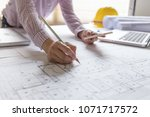 architect hands working on... | Shutterstock . vector #1071717572
