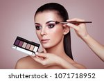makeup artist applies eye... | Shutterstock . vector #1071718952