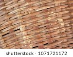 brown woven bamboo close up... | Shutterstock . vector #1071721172
