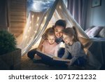 family bedtime. mom and... | Shutterstock . vector #1071721232