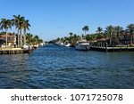 water canal with boats and real ... | Shutterstock . vector #1071725078