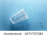 disposable plastic cup with... | Shutterstock . vector #1071737282