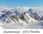 a wintertime view from mt.... | Shutterstock . vector #1071756356