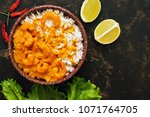 thai shrimp dish in curry sauce ... | Shutterstock . vector #1071764705