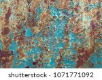 green rusty old painted metal... | Shutterstock . vector #1071771092