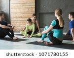 yoga teacher and beginners in...   Shutterstock . vector #1071780155