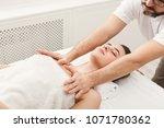 man massaging female shoulders. ... | Shutterstock . vector #1071780362