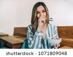 woman close up eating oat and... | Shutterstock . vector #1071809048