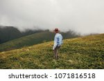 stylish traveler man in hat... | Shutterstock . vector #1071816518