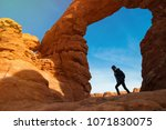 young woman traveler with... | Shutterstock . vector #1071830075