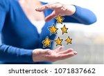 quality concept between hands... | Shutterstock . vector #1071837662