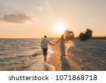 a loving couple going to the... | Shutterstock . vector #1071868718