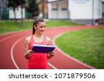 portrait of female fitness...   Shutterstock . vector #1071879506