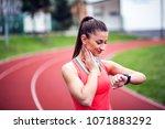 female runner looking at her...   Shutterstock . vector #1071883292