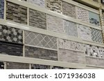 Stock photo image of a wall of tile samples at a home improvement warehouse store 1071936038