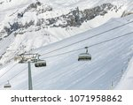 a wintertime view on mt. titlis ... | Shutterstock . vector #1071958862
