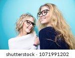 two pretty cheerful girls in... | Shutterstock . vector #1071991202