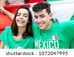 soccer fans from mexico with... | Shutterstock . vector #1072047995