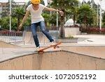 skateboarder on skatepark ramp | Shutterstock . vector #1072052192