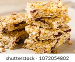 a stack of granola bars on... | Shutterstock . vector #1072054802