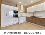 kitchen with appliances and a... | Shutterstock . vector #1072067858