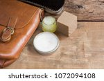 old genuine leather bag on... | Shutterstock . vector #1072094108