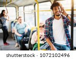 a group of people traveling by... | Shutterstock . vector #1072102496