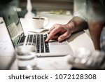 business man in office with... | Shutterstock . vector #1072128308