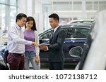 car dealership salesman showing ... | Shutterstock . vector #1072138712
