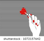 pop art hand. striped... | Shutterstock .eps vector #1072157642