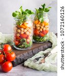 Small photo of Fresh salad lunch with chickpeas, tomatoes, carrots and valerian served in mason jars