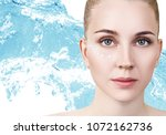 woman with cream dots on face... | Shutterstock . vector #1072162736