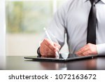 writing or signing on digital... | Shutterstock . vector #1072163672