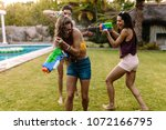 group of women at the poolside... | Shutterstock . vector #1072166795