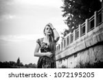 black and white photo. a girl... | Shutterstock . vector #1072195205