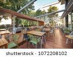 modern restaurant terrace in... | Shutterstock . vector #1072208102