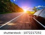 car on asphalt road in summer | Shutterstock . vector #1072217252