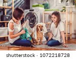 mother and daughter with small... | Shutterstock . vector #1072218728