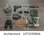 Small photo of Set of military equipment on wooden background, flat lay