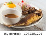 fried fish with rice with... | Shutterstock . vector #1072251206