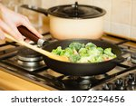 woman in kitchen cooking stir... | Shutterstock . vector #1072254656